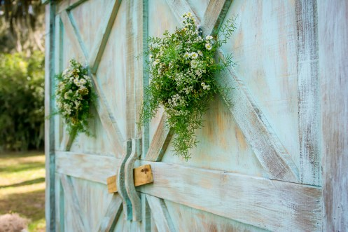 Ceremony floral decor filled with Greens and white Wildflowers.