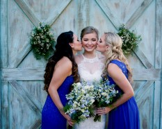 White Wildflower Bridal Bouquet with pops of Blue Delphinium and Corn Flower, with our Wildflower Maids' bouquets filled with greens, white Asters, and blue Delphinium.