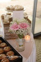 Toss bouquet filled with babies breath and blush gerber daisies.