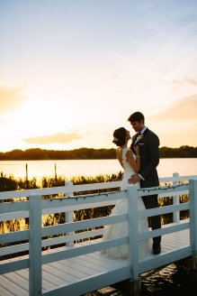 Perfect sunset picture on the dock at the Bride's family home.