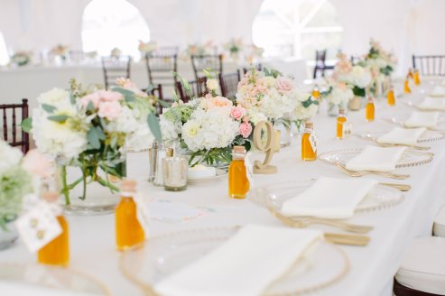 Each table had at least 4 centerpieces of soft pastel floral and gold mercury votives.