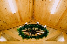 Garlands were added to all three chandeliers in the new mess hall. Bringing the outdoors in was the bride's vision.