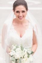 Brides bouquet was created using white football mums, white ranunculus, white stock, white tibet roses, silver dollar eucalyptus, and white majolika spray roses.