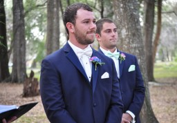 The groom's bout was a mix of hot pink freesia, ivy and bright blue delphinium blooms, while the best man enjoyed a bout of ivy, freesia, and white hypericum.