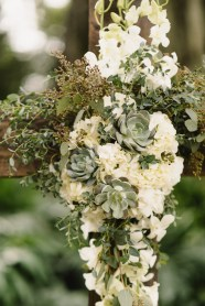 Ceremony cross floral of hydrangea, roses, succulents and trailing greens.