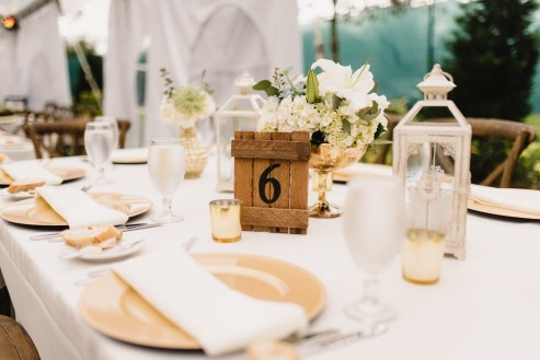 Gold mercury containers and antique lanterns were one style of centerpiece.