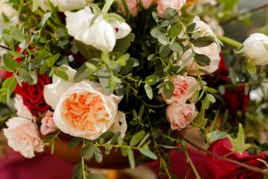Peach Juliet David Austin garden roses accented with ranunculus, spray rose and greens.