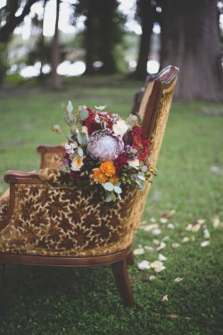 Brides Brides flower halo made of yellow and burgundy mums and bouquet created with yellow and burgundy mums, purple snap dragons, hypericum berries, proteas, ivory standard roses, and greens.