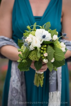 Bridemaids bouquets made with thistle, garden roses, bupleurum, hypericum berries and green hydrangea.