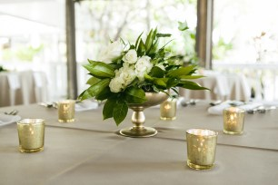 Gold compote design with greenery and white floral
