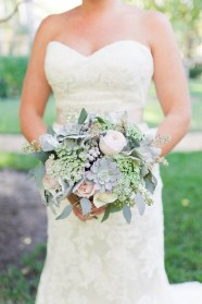 Brides bouquet with roses, succulents, eucalyptus, queens anne lace, and brunia.