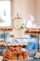 Wedding cake with O'hara garden roses, freesia, and seeded eucalyptus.