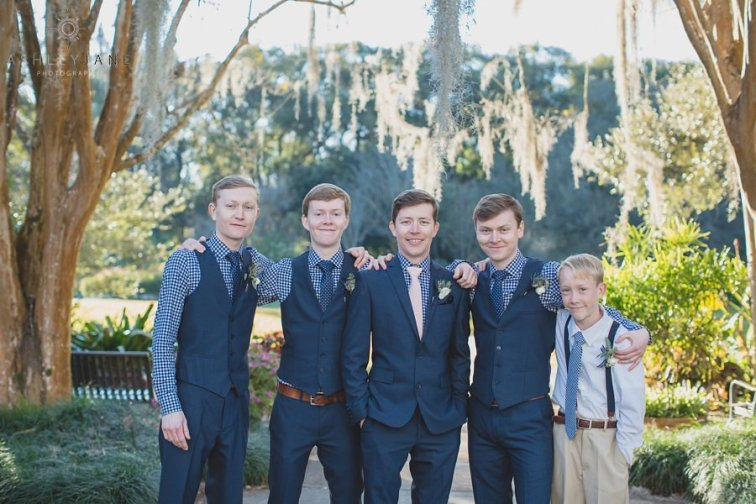 Groomsmen boutonnieres with white ranunculus, thistle, and seed eucalyptus.