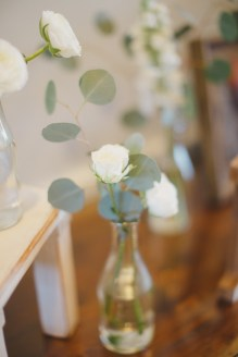 Simple bottles with eucalyptus and white floral