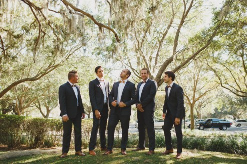 Groom and his groomsmen in wooden bow ties