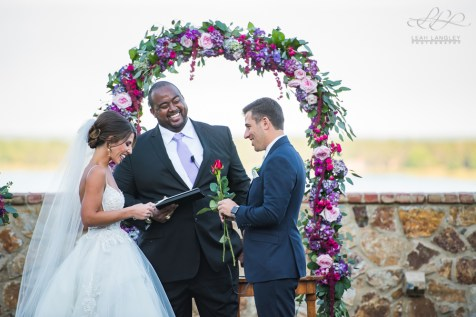 This jewel toned arch created the perfect backdrop for this couple to create one of the most important memories of their lives.