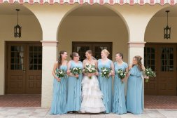 Lovely maids in blue standing with the bride.