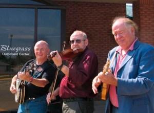 Neil Rosenberg, Mayne Smith, and Peter Feldmann undergoing bluegrass therapy in 2005.