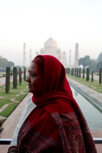 Woman in red sari at Taj Mahal