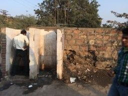 Man urinating India