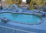 in ground swimming pool builder Michigan Clarston, Milford, Fenton, Oxford, Lansing, Shelby Mi. inground Swimming pool Installation Clarkston Michigan Swimming Pool Sale www.bluehawaiianpoolsofmichigan.com 12 - blue hawaiian pools of michigan sea swirl pool 09A