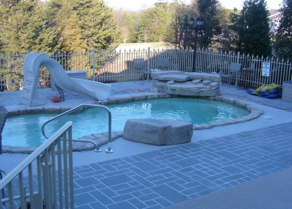in ground swimming pool builder Michigan Clarston, Milford, Fenton, Oxford, Lansing, Shelby Mi. inground Swimming pool Installation Clarkston Michigan Swimming Pool Sale www.bluehawaiianpoolsofmichigan.com 16 - blue hawaiian pools of michigan sea swirl pool 9b