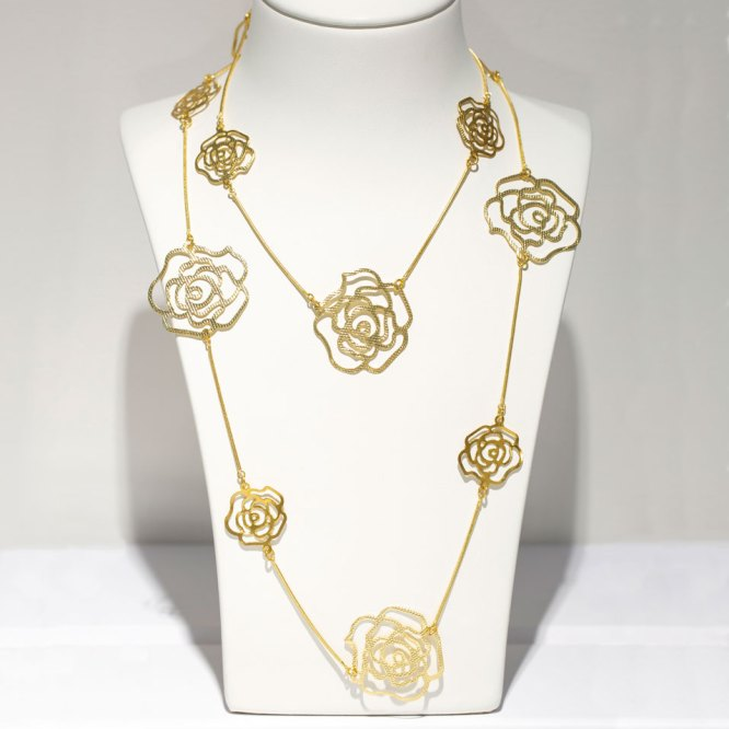 Yellow Gold Small & Large Roses Necklace on a white display element.