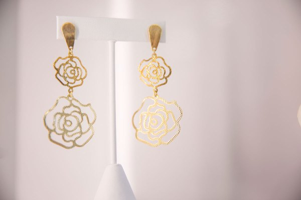 Yellow Gold Double Rose Earrings on an element.