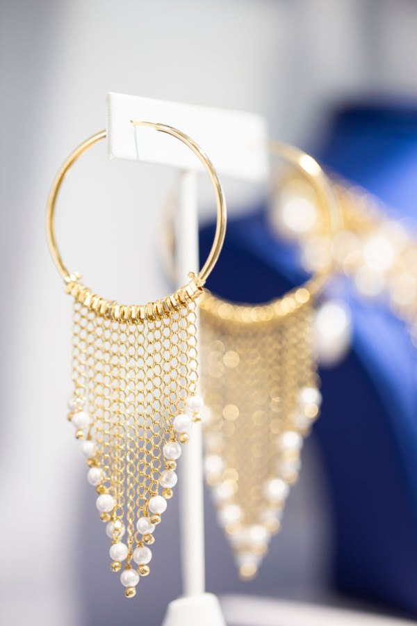 18KY Plated Pearl Dangles from Hoop Earrings in showroom on an element.