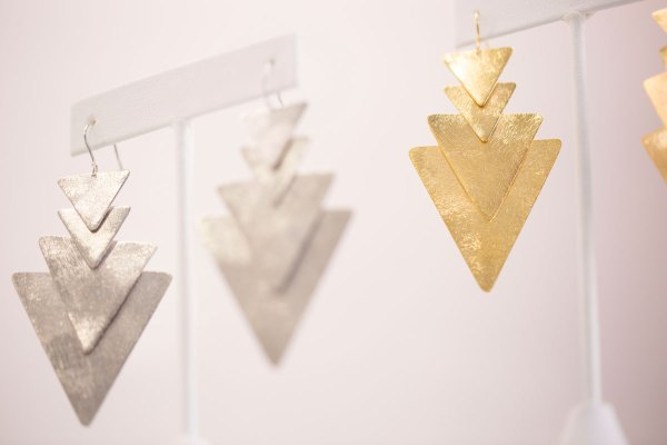 Rhodium and Yellow Gold 4 Triangle Dangle Earrings in showroom.