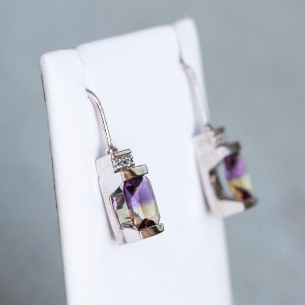 Ametrine Quartz & White Sapphire Earrings side view on a white display element.