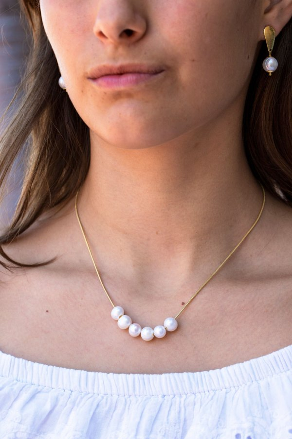 Yellow Gold 6 Pearl Strand Necklace on a model.