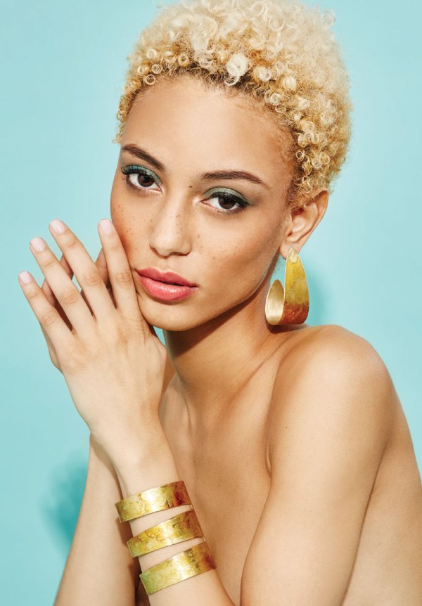 Gold Angle Cuff on a model.