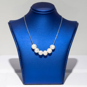 Rhodium 6 Pearl Strand Necklace front view on a blue display element.