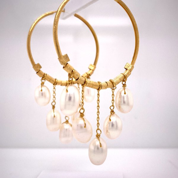 Yellow Gold Pearl Drop Hoop Earrings side view up close on pearls.