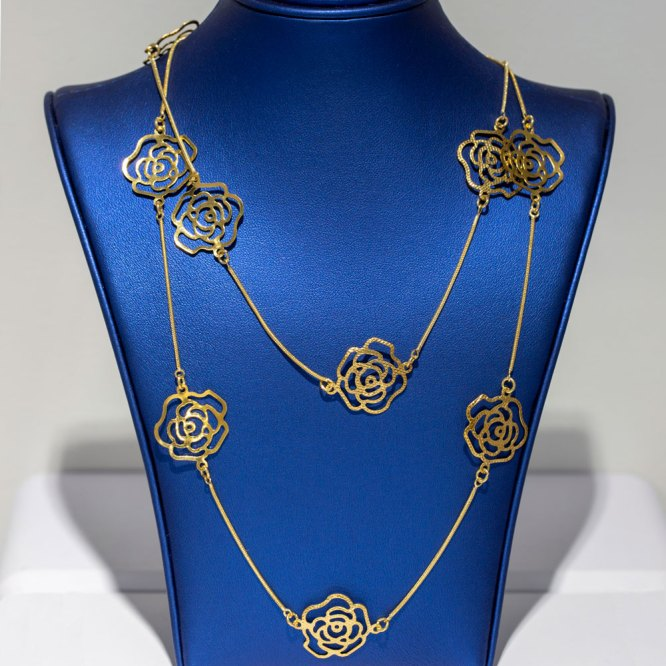 Yellow Gold Small Roses Necklace front view on a blue display element.