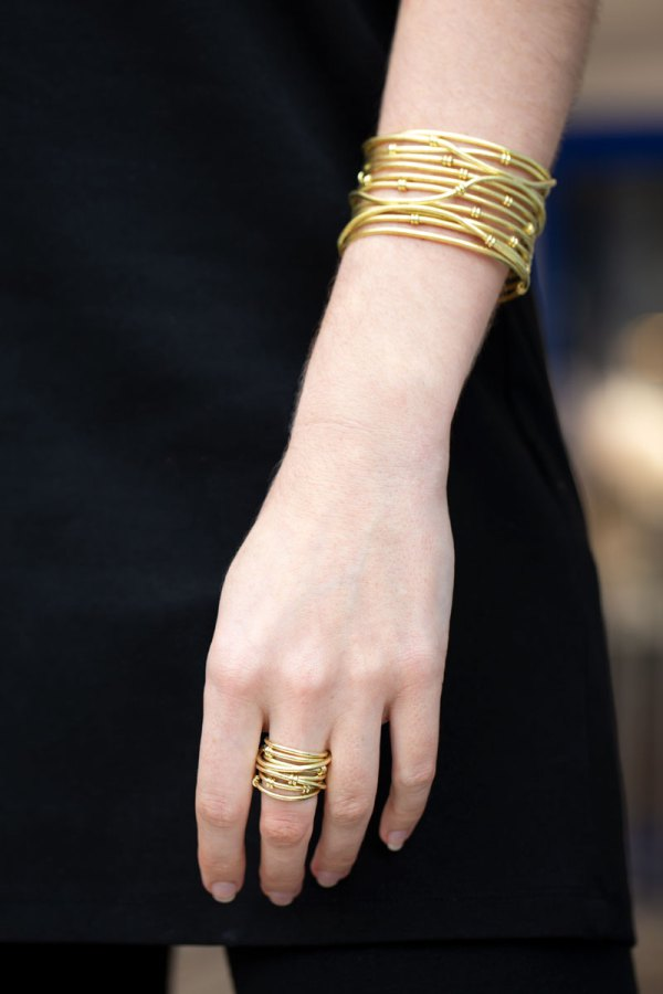 Yellow Gold Satin Row Cuff and Satin Row Ring on a Model.