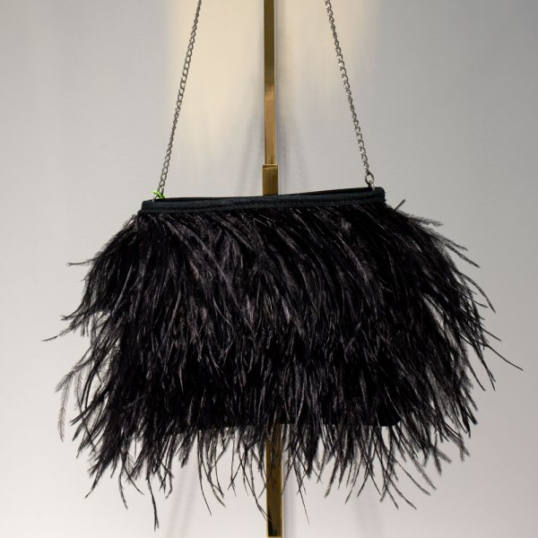 Fancy Black Ostrich Feather handbag front view hanging on a gold stand.