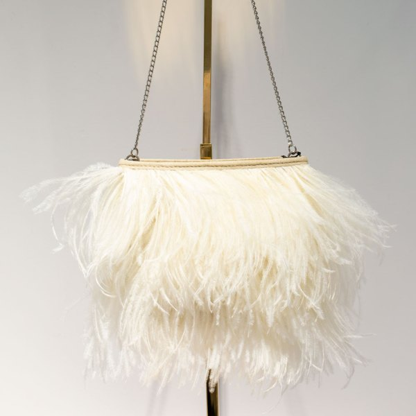 Fancy White Ostrich Feather Handbag front view hanging on a gold stand.