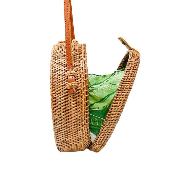 Camilla Rattan Bag side view open showing Palm Leaf interior accent.
