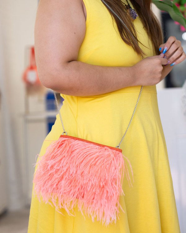 Coral Fancy Bag with Chain on a models shoulder.