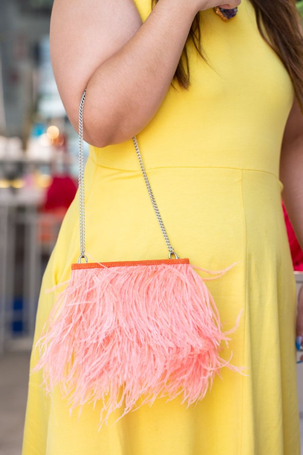 Coral Fancy Bag with Chain on a models forearm.