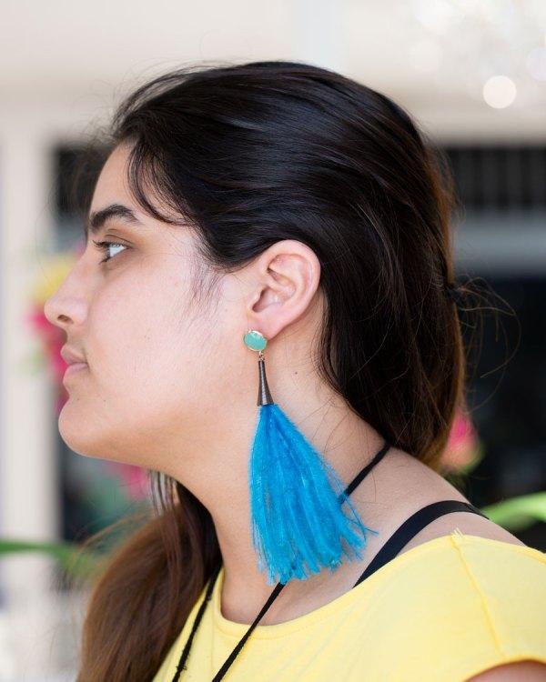 Light Blue Fluffy Earrings with Bling on a model.