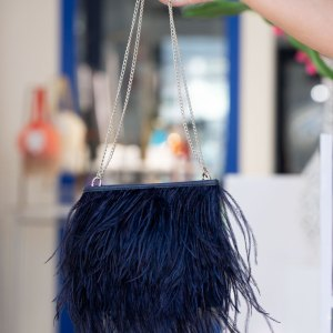 Black Fancy Bag with Chain held in a models hand with shortened chain handle.