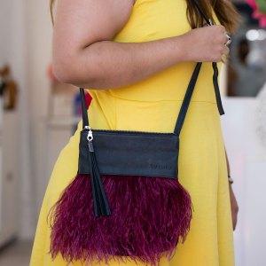 Berry Helen Handbag over a models shoulder.