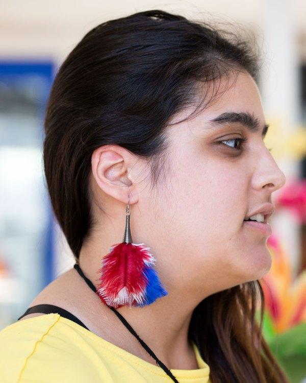 Red, White, & Blue Fluffy Earrings on a model.