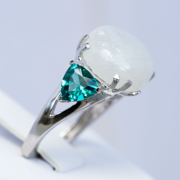 Moonstone Caribbean Blue Quartz Ring side view on a white display element.
