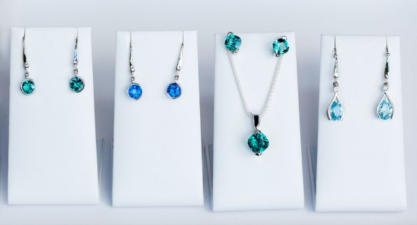 Photo of various earrings and one pendant of kashmir, caribbean, and aqua blue color.