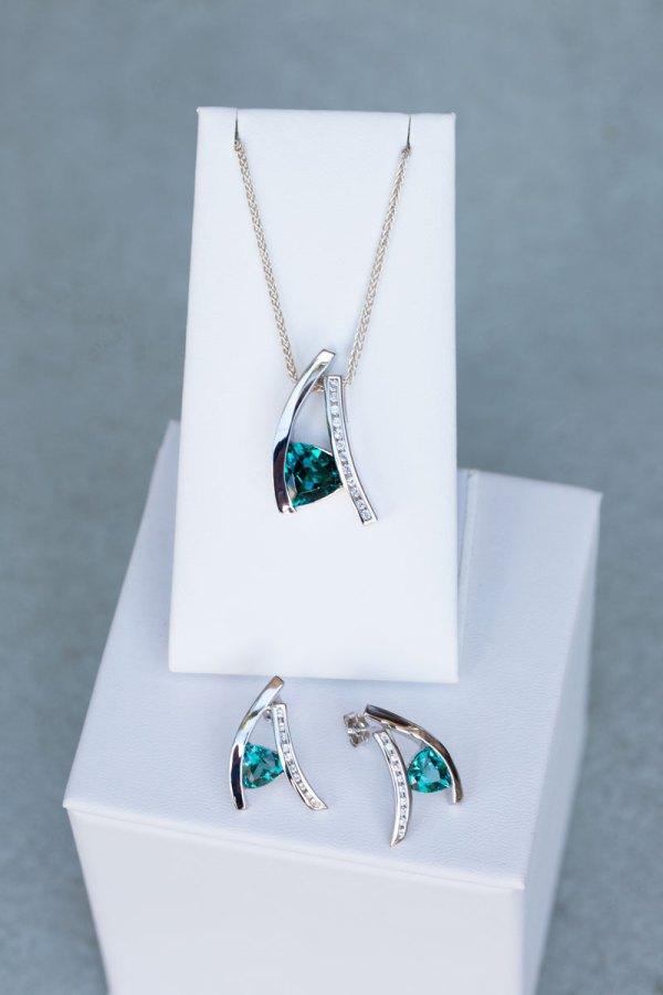 Trillion Cut Caribbean Blue Quartz & White Sapphire Pendant & Earrings on a white display element.