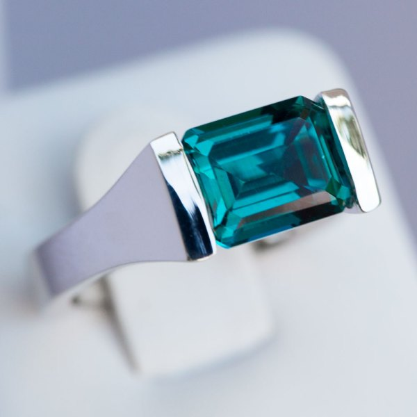 Emerald Cut Caribbean Blue Quartz Ring angle view.